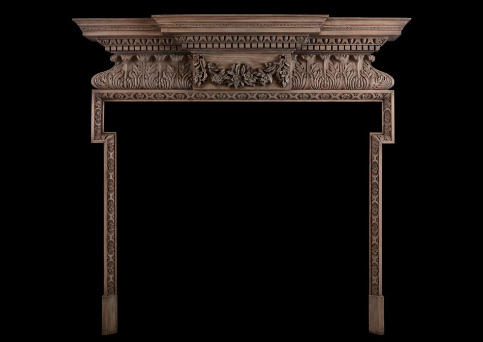 A carved pine fireplace