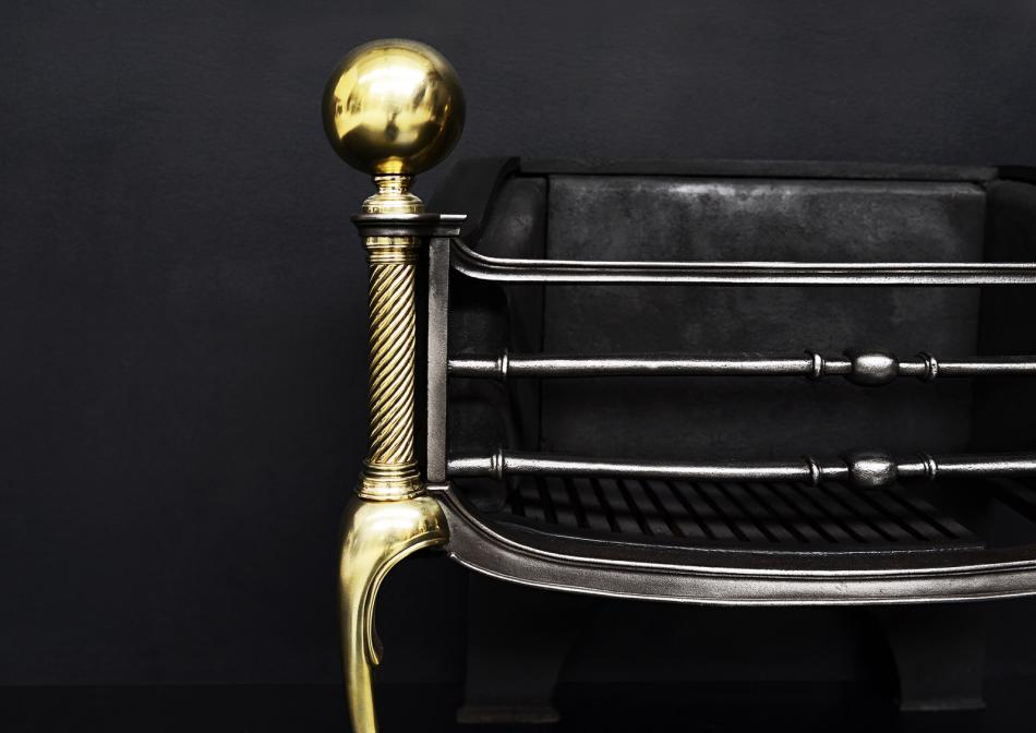 An elegant brass and steel firegrate