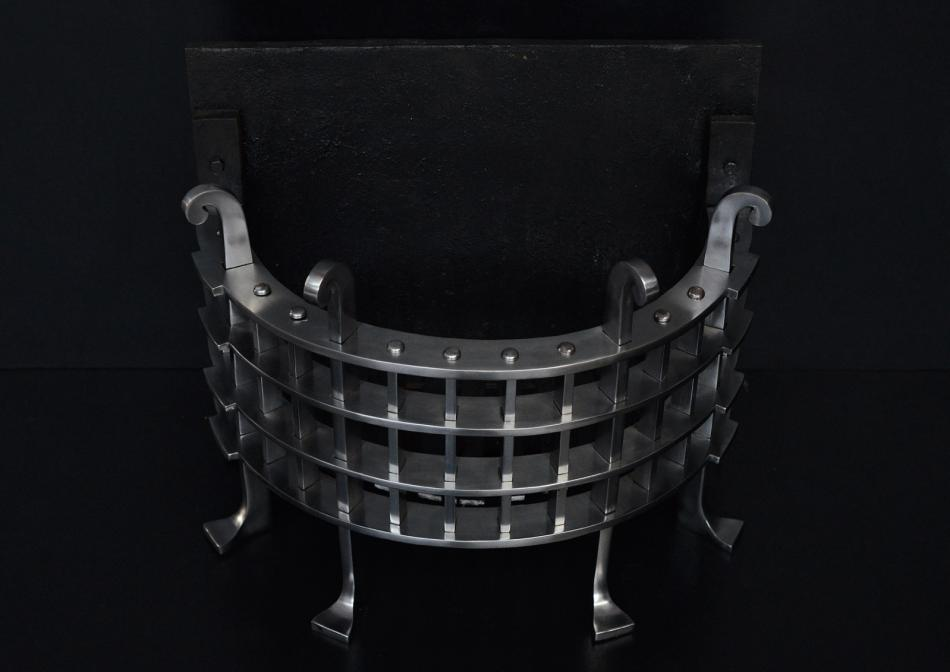 A half round fire grate in the Gothic style