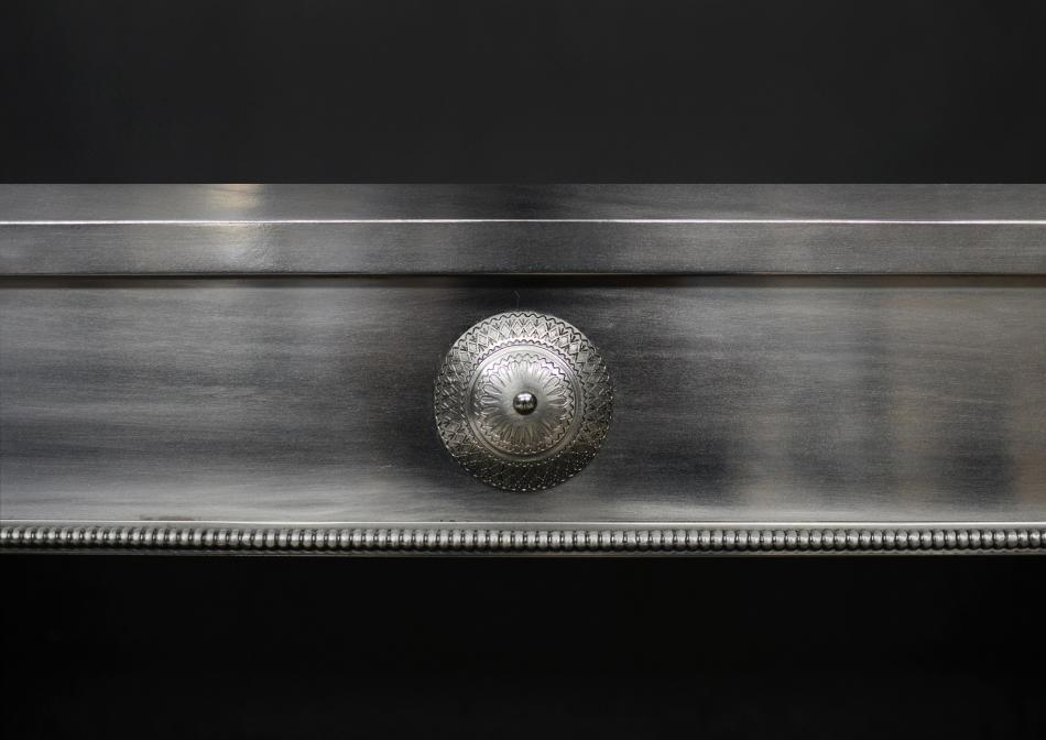 A polished steel register grate in the Georgian manner