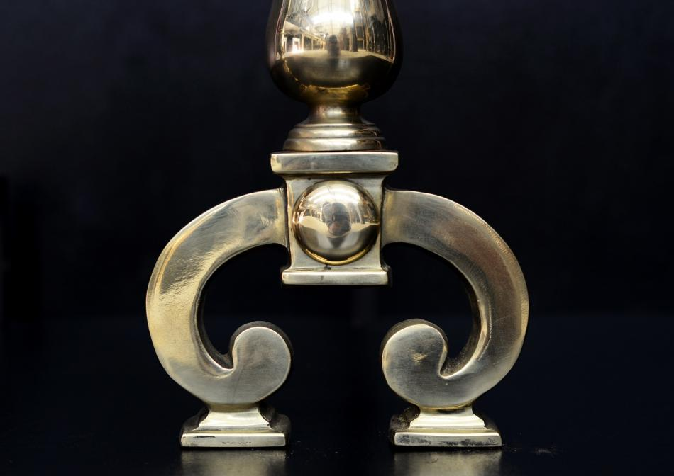 A pair of polished brass firedogs with beading to top
