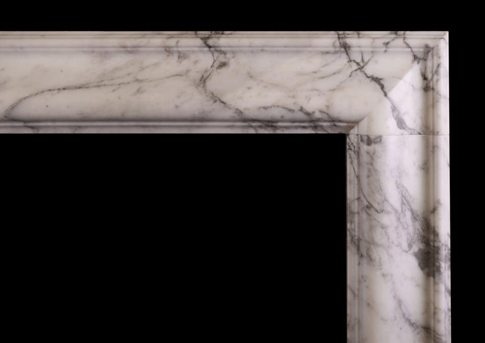An English moulded bolection fireplace in Italian Arabescato marble