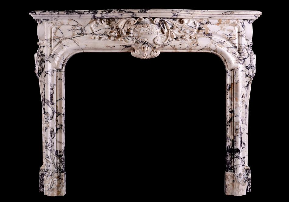 A Breccia Louis XIV/XV transitional fireplace