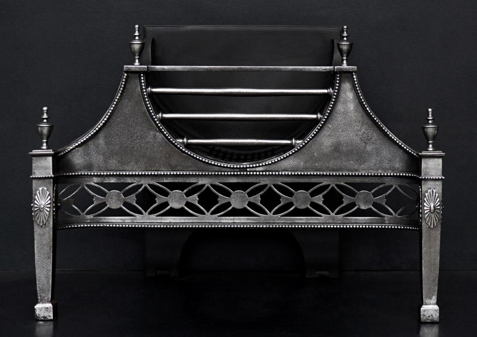 A Georgian style cast iron firegrate