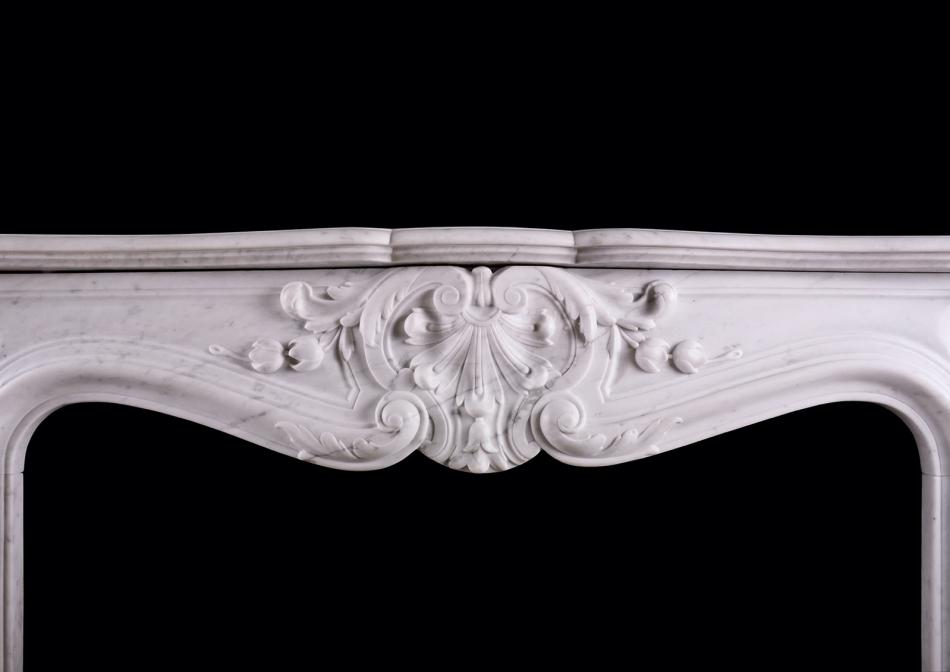 A 19th century French marble fireplace in the Louis XV manner