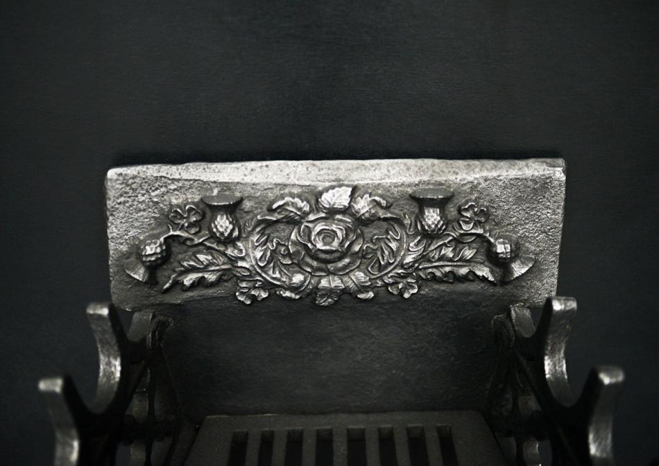 A Neo-Gothic style firegrate