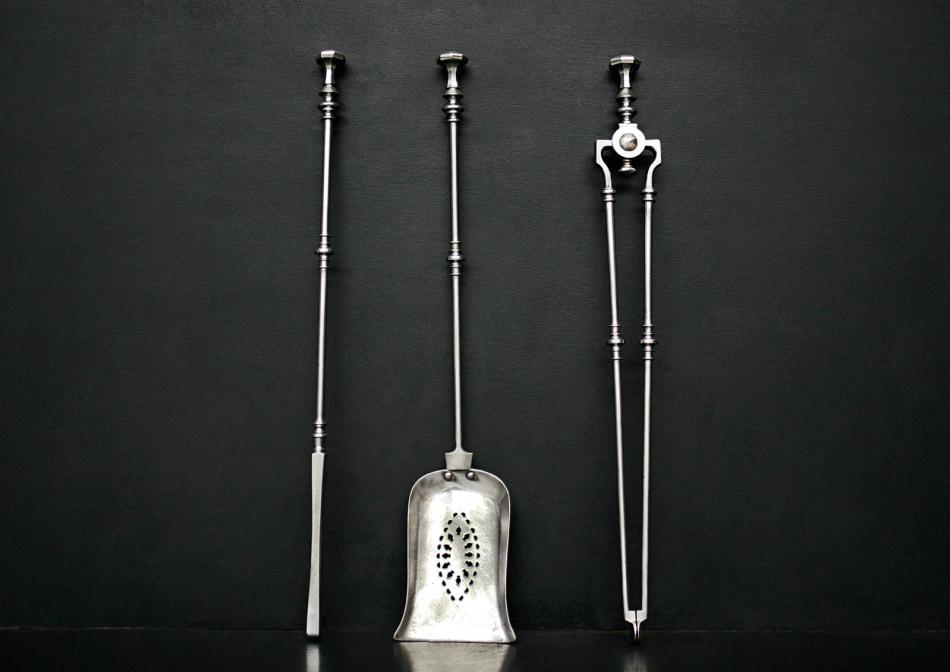Set of polished steel firetools