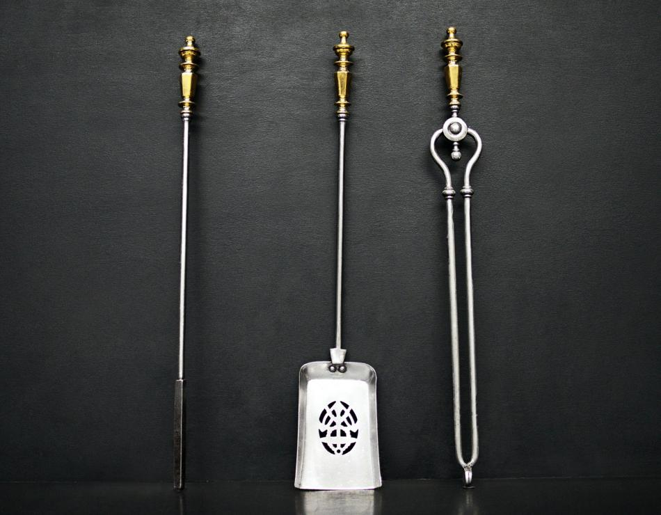 A set of brass and steel firetools