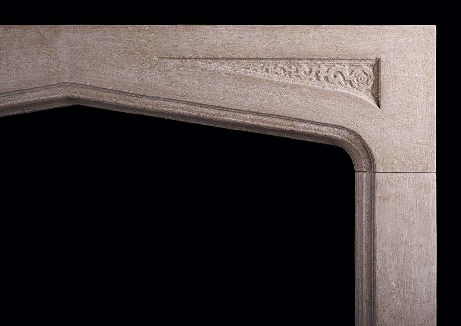 A carved Gothic stone fireplace