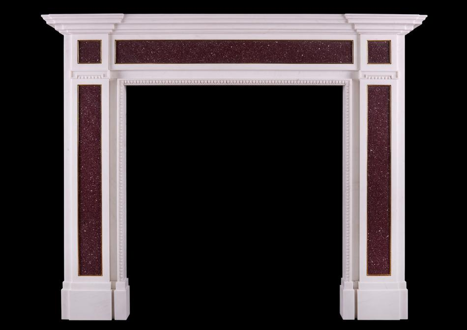 A white marble and Porphyry fireplace in the Regency manner