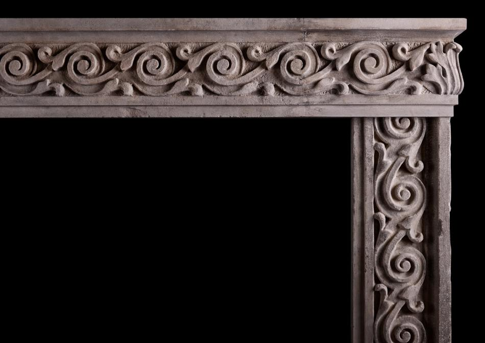 An impressive carved stone Italian fireplace