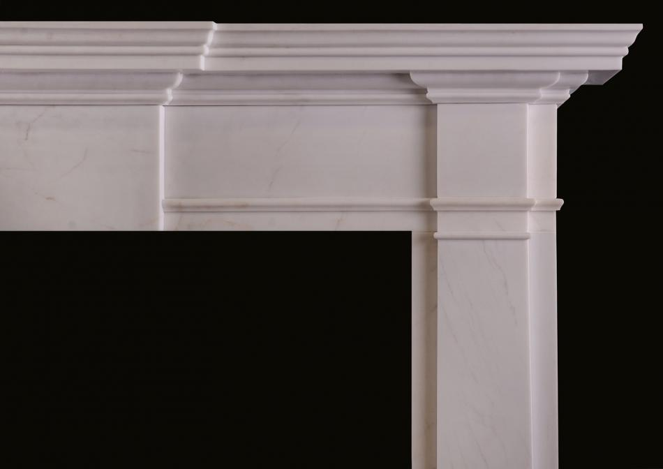 An mid-sized English fireplace in white marble