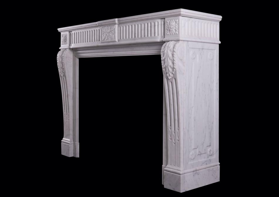 A carved Carrara marble fireplace in the Louis XVI manner