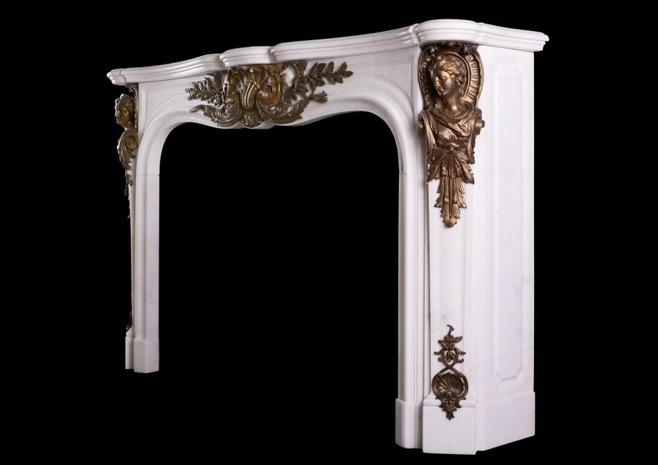 A Statuary marble fireplace with bronze ormolu