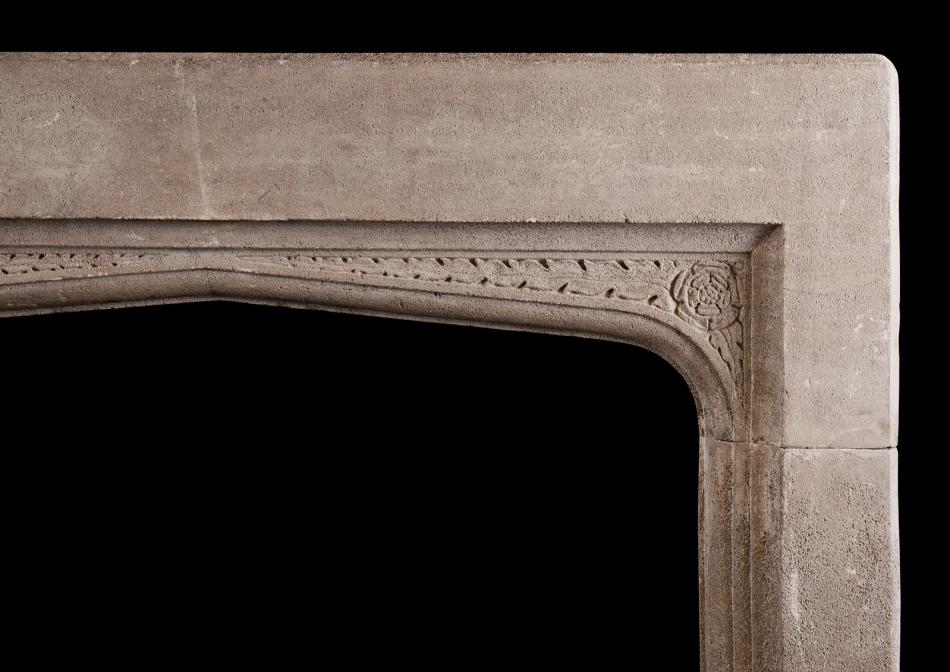 An English stone fireplace in the Gothic manner