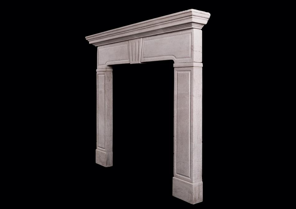 A late Regency style limestone fireplace