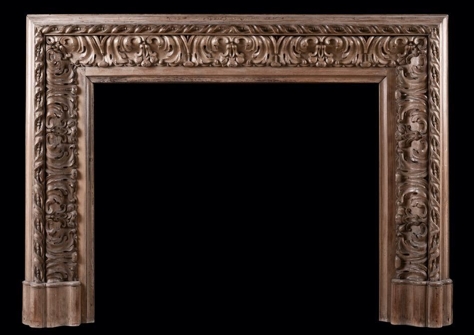 A carved wood bolection fireplace
