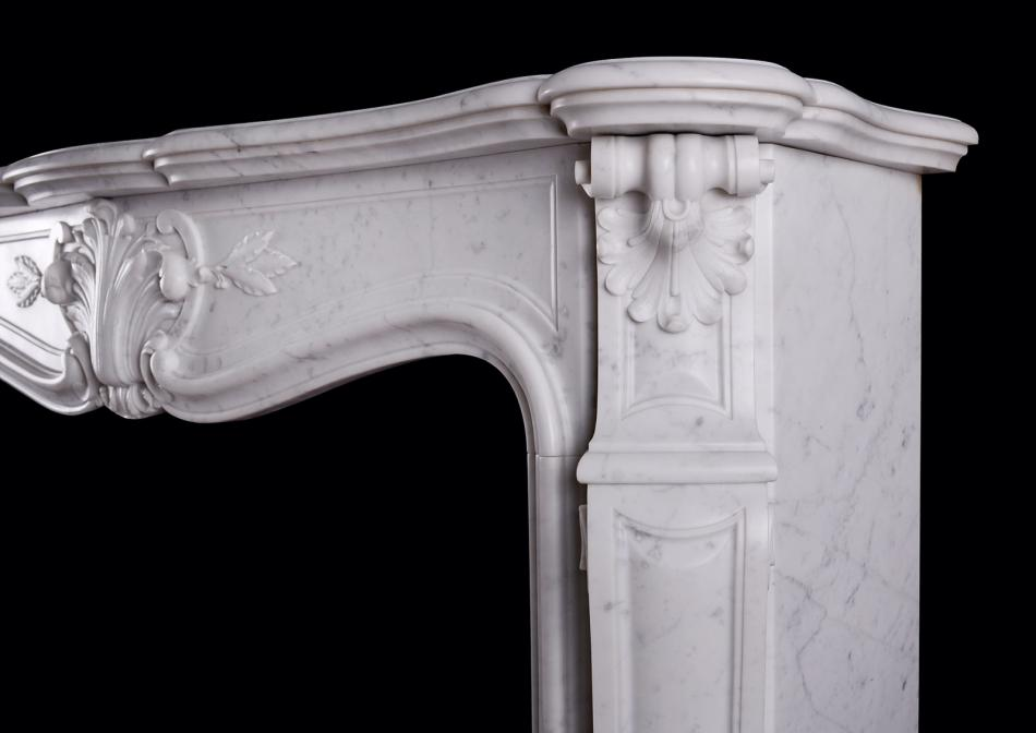 A Carrara marble fireplace in the Louis XV manner