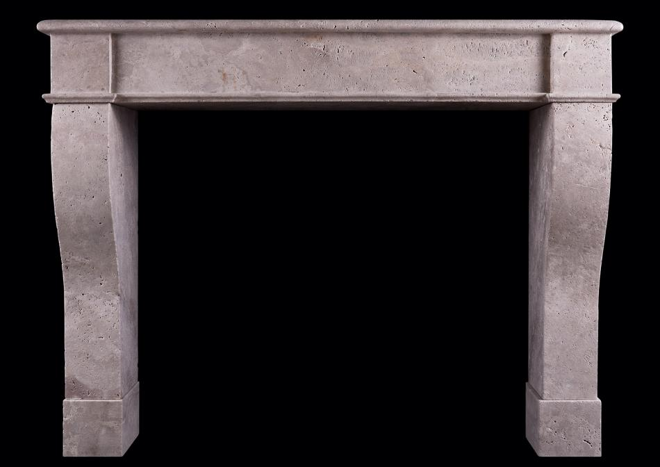 A rustic French fireplace in Travertine stone
