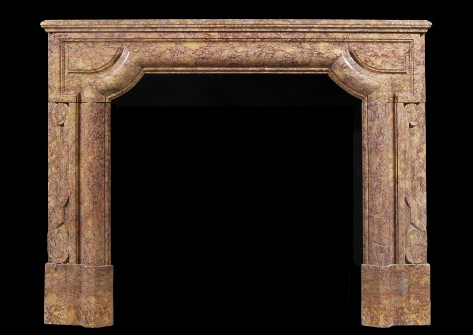 An architectural fireplace in Brocatelle marble
