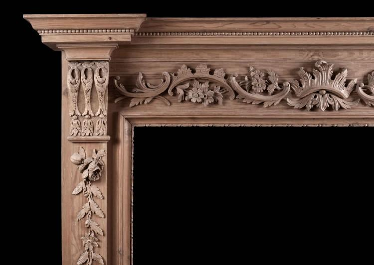 AN ENGLISH PINE FIREPLACE WITH CARVED FRUIT AND FOLIAGE-Detail1