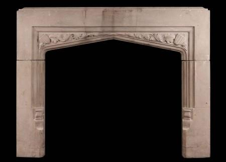 AN ENGLISH CAST STONE FIREPLACE IN THE GOTHIC STYLE