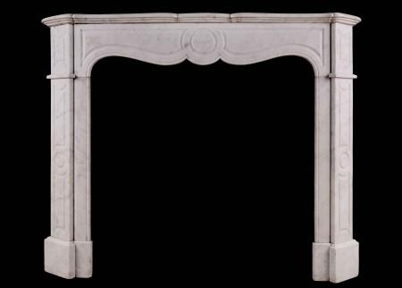 A 19TH CENTURY FRENCH POMPADOUR FIREPLACE IN CARRARA MARBLE