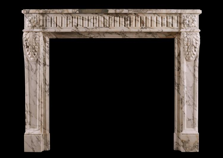 A French Louis XVI fireplace in Serravezza Breccia marble