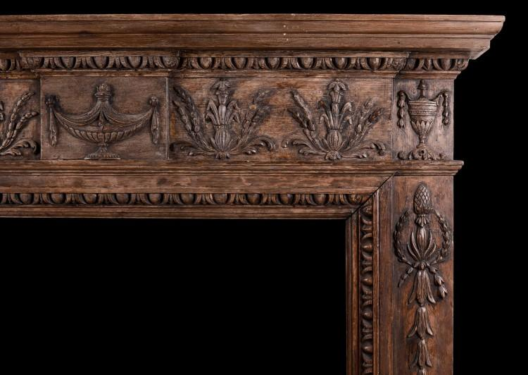 AN ENGLISH CARVED WOOD FIREPLACE IN THE LATE GEORGIAN STYLE-Detail1
