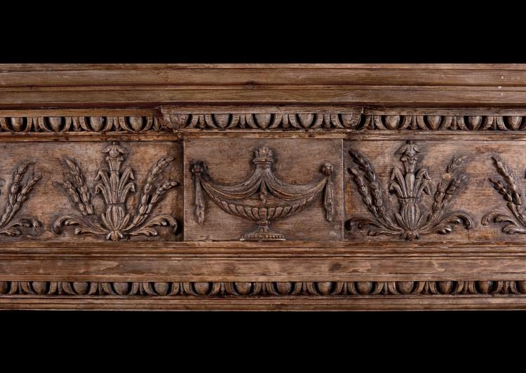 AN ENGLISH CARVED WOOD FIREPLACE IN THE LATE GEORGIAN STYLE-Detail2