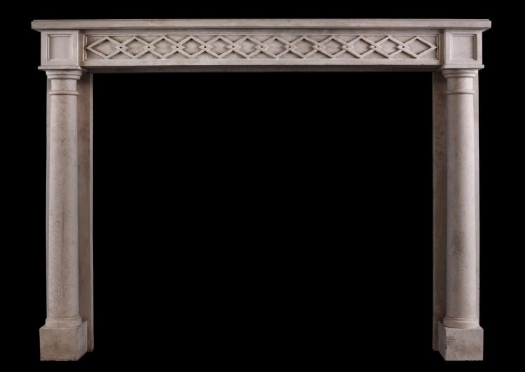 A French Empire style limestone fireplace