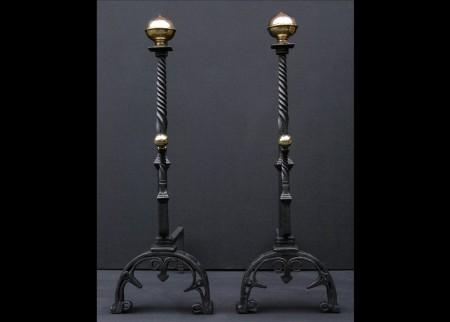 A PAIR OF WROUGHT IRON FIREDOGS WITH BARLEY TWIST SHAFTS