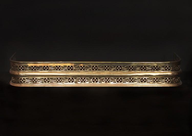 A pierced brass fender