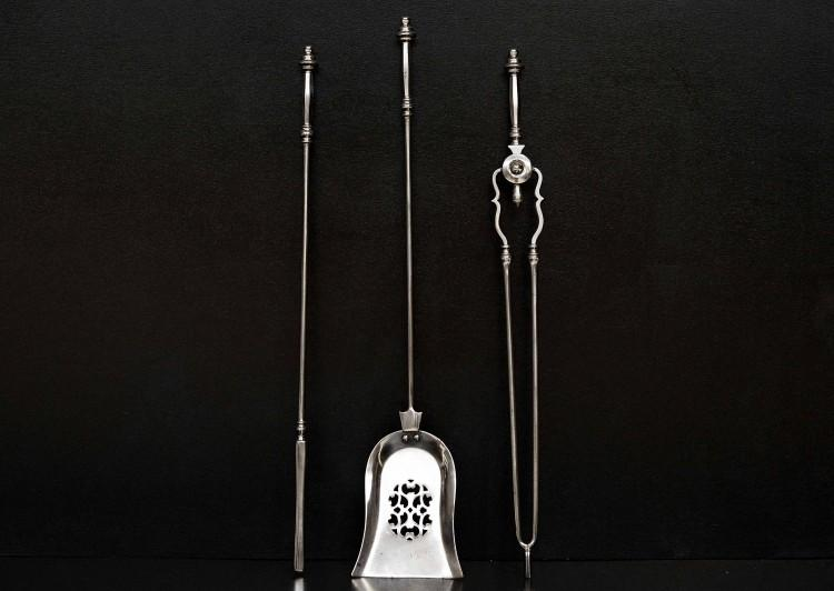 A set of good quality English polished steel firetools
