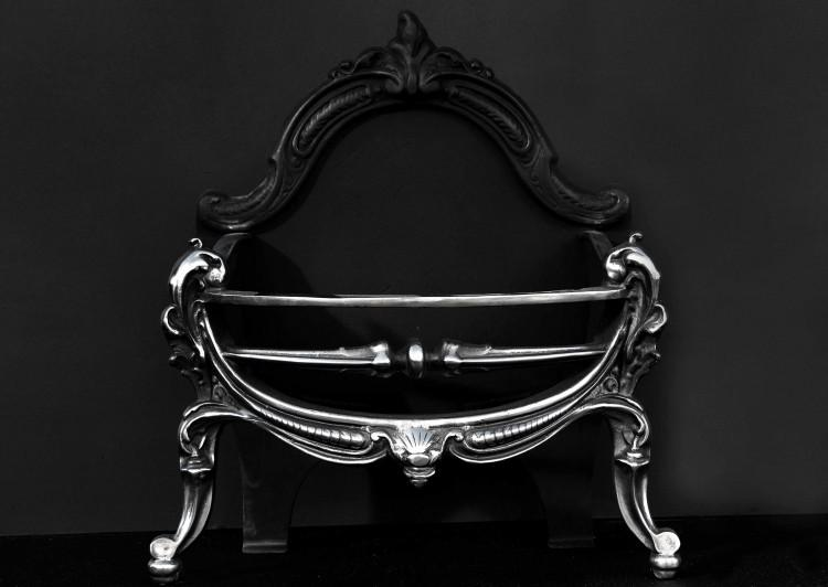 A polished cast iron firebasket in the Rococo manner