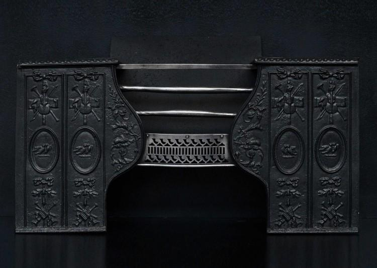 An early 19th century cast iron hob grate