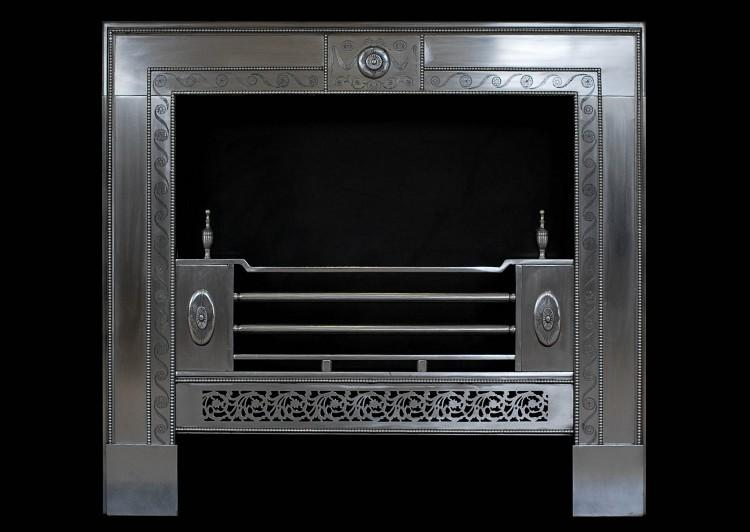 A fine quality engraved George III style steel register grate