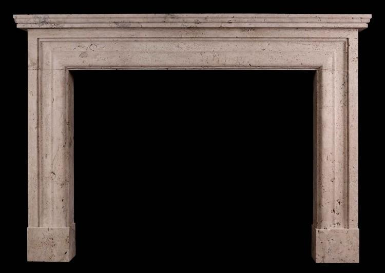 An Imposing English Bolection Fireplace in Travertine Stone