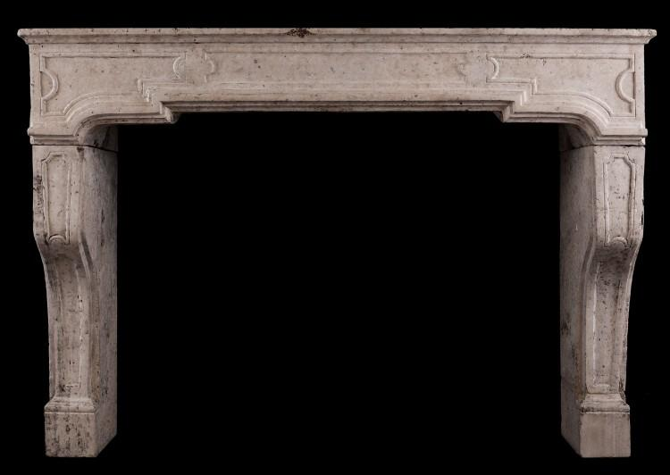 An architectural stone fireplace