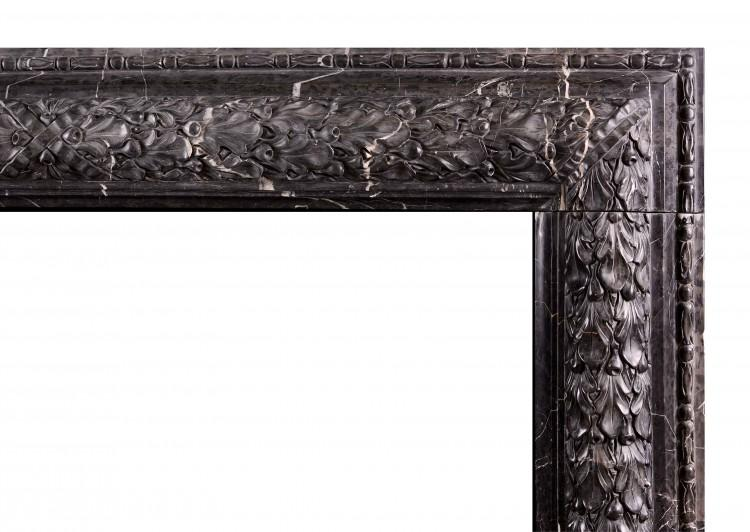 AN ELEGANT CARVED BOLECTION FIREPLACE IN NERO MARQUINA MARBLE-Detail1