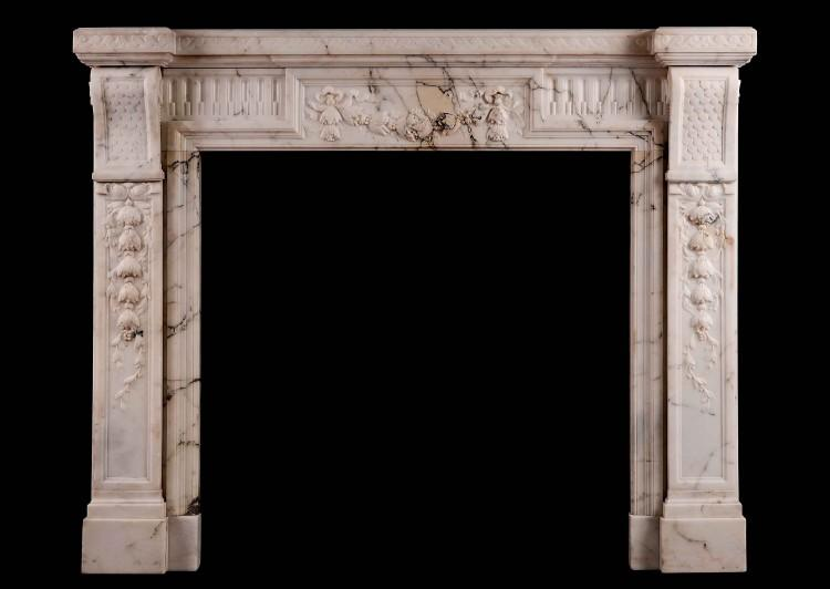 A French Louis XVI Style Fireplace in light Pavonazza marble