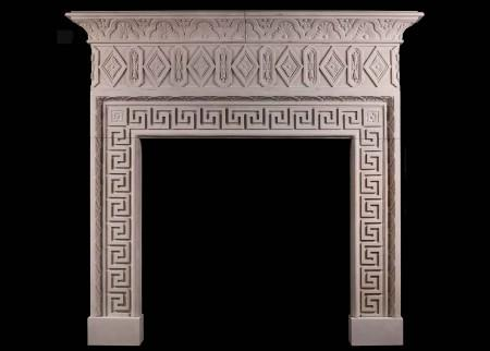 A LARGE ITALIAN LIMESTONE CHIMNEYPIECE WITH CLASSICAL GREEK KEY MOTIF