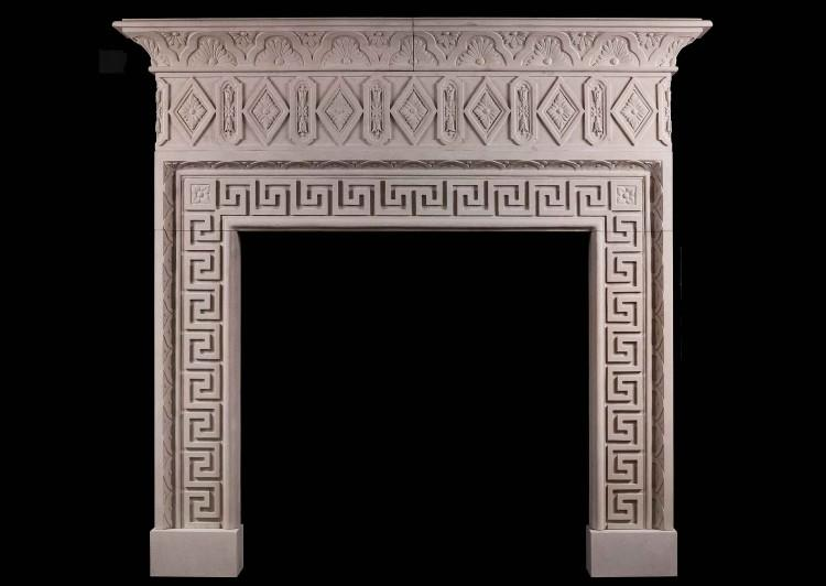 A large limestone chimneypiece with classical Greek key motif
