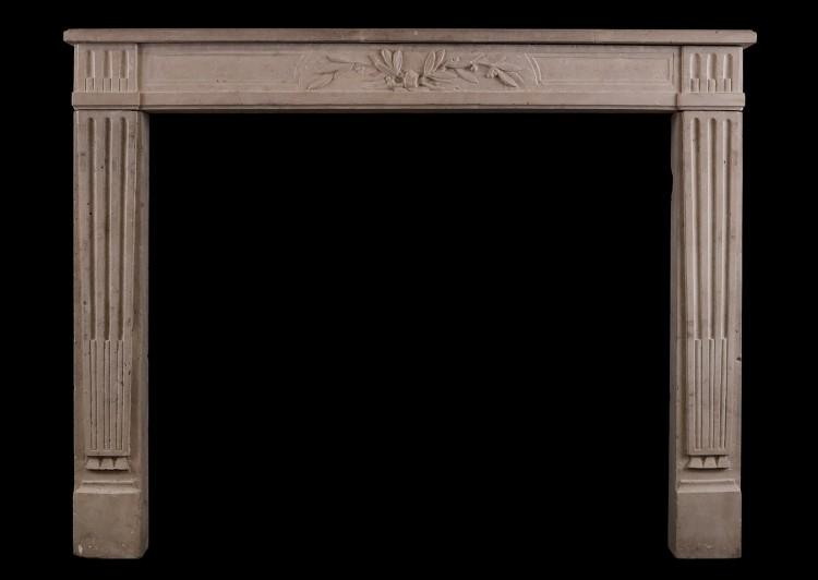 A Louis XVI style limestone antique fireplace