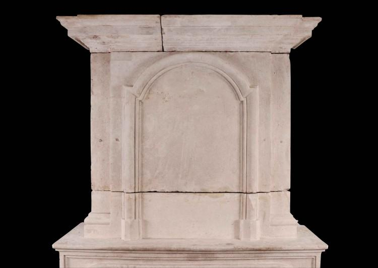 A EARLY 18TH CENTURY FRENCH LOUIS XIV LIMESTONE FIREPLACE WITH PANELLED TRUMEAU-Detail1