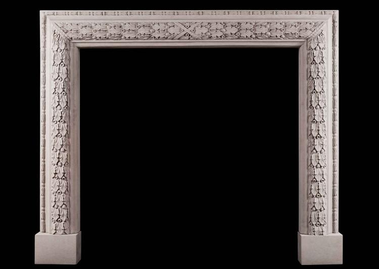 An elegant carved bolection fireplace in limestone