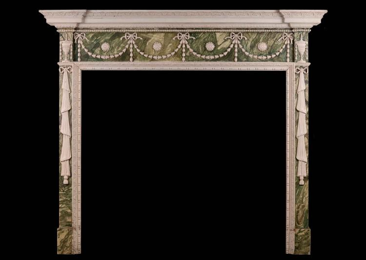 A faux marble Adam style wood fireplace with gesso enrichments