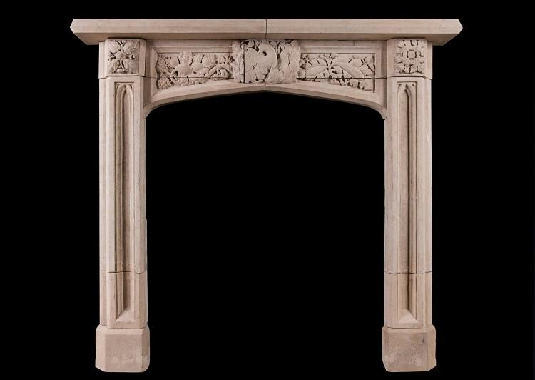 A well carved English, Gothic Revival Bath stone fireplace
