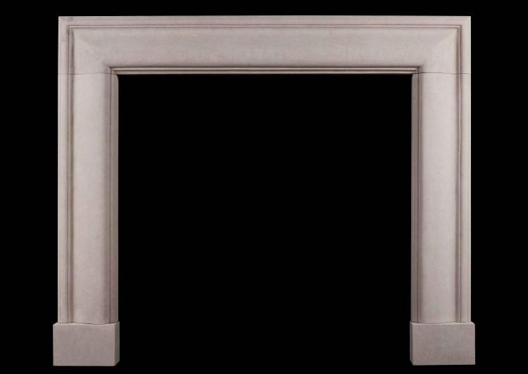 An English moulded bolection fireplace in Portland stone