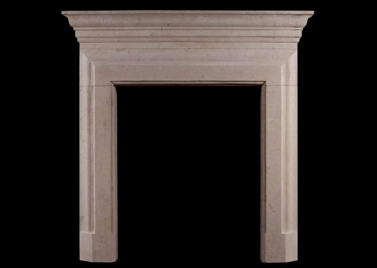 An English limestone fireplace of architectural form